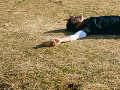 Young man lying on the field