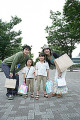 Mid adult couple and their two daughters holding shopping bags