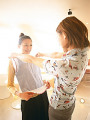 Young women trying on new blouse