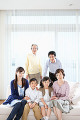 Asian family posing together and looking at camera