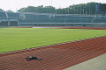 Fallen businessman on running track