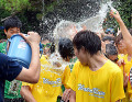 Japan Water Run in Japan July 23  2016  Chiba  Japan - Japanese youths get a bucketful water from a staff at the Water Run at a beach in Chiba  suburb Tokyo on Saturday  July 23  2016. Some 10 000 people enjoyed the the two-day event with water guns and a total of 300 000 water balloons.      Photo by Yoshio Tsunoda/AFLO  LWX -ytd-