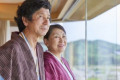 Japanese senior couple wearing yukata at a traditional hotel