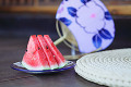 Sliced Watermelon And Paper Fan