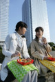 Two female office workers having lunch
