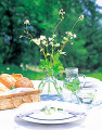 Bread And Tableware On An Outdoor Table