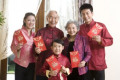 Family holding Chinese red envelope