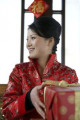 Woman In Traditional Clothing Holding Gift