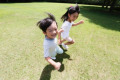 Happy Japanese kids in a city park