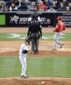 MLB: New York Yankees vs Los Angeles Angels Masahiro Tanaka  Yankees   APRIL 27  2014 - MLB : Pitcher Masahiro Tanaka of the New York Yankees reacts after giving up a home run to David Freese of the Los Angeles Angels who crosses home plate in the sixth inning during the Major League Baseball game at Yankee Stadium in Bronx  New York  United States.  Photo by AFLO