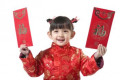 Young girl holding Chinese New Year red envelop
