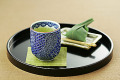 Japanese Green Tea Served With Small Sweet