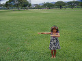 Little hula girl dancing at the field