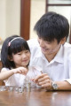 Father and daughter counting coins