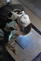 High angle view of a welder welding in a workshop