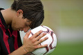 Soccer player praying for victory