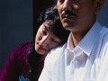 Japanese woman leaning on man acute;s shoulder