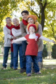 Three Generation Family Playing in a Park in Autumn