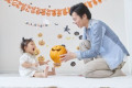 Japanese child and father getting ready for Halloween