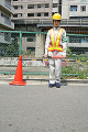 Portrait of a female traffic cop holding a nightstick