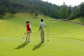 Couple Stands on a Golf Course