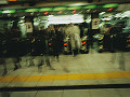 Commuters going though turnstile  blurred motion