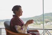 Japanese senior woman wearing yukata at a traditional hotel