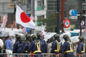 72nd Anniversary of Japan s Surrender in WWII at Yasukuni Shrine Police officers try to control Japanese nationalists protesters near to Yasukun