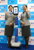 Avatar in store December 4 2019 Tokyo Japan  Japanese largest air carrier All Nippon Airways ANA cabin attendants smiles with ANA s avatar