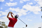 Japanese golfer on course