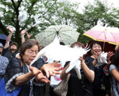 Japan remembers war dead at Yasukuni Shrine August 15 2017 Tokyo Japan  People release white doves in the air to pray for peace at the controversi