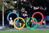 Tokyo 2020 preview MARCH 26 2020 Olympic rings are seen through cherry blossoms at Japan Sport Olympic Square in Tokyo Japan Photo by Kenichi Ar