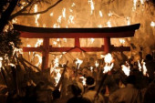 Shingu Oto matsuri fire festival Festival goers holding torch gather inside the shrine during Oto matsuri festival at Kamikura shrine in Shingu City