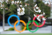 Tokyo 2020 preview MARCH 27 2020 Olympic rings are seen through cherry blossoms at Japan Sport Olympic Square in Tokyo Japan Photo by Kenichi Ar