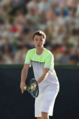 Young caucasian tennis player on court