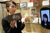Avatar in store December 4 2019 Tokyo Japan  Mitsukoshi department store sales clerk displays a gift box of sweets to All Nippon Airways  A