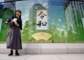 Calligraphic work showing Japan s new imperial era Reiwa May 4 2019 Tokyo Japan  A woman stands next to a calligraphic work on display showi