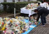 A fan of Japanese comedian Shimura Ken offers a prayer for Shimura who died by the new coronavirus March 31 2020 Tokyo Japan  A fan of Japanese co
