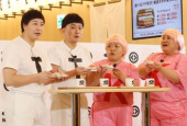 Japanese comedians attend the opening event of the flagship restaurant of conveyor belt sushi chain January 22 2020 Tokyo Japan  L R Japanese c