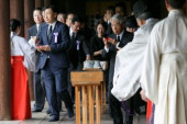 72nd Anniversary of Japan s Surrender in WWII at Yasukuni Shrine A group of lawmakers including Hidehisa Otsuji C  follow a Shinto priest to