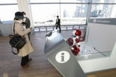 Tokyo s new Takanawa Gateway Station A woman looks at a travel guidance robot at the new Takanawa Gateway Station on March 18 2020 Tokyo Japa