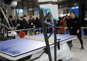 International Robot Exhibition 2019 December 18 2019 Tokyo Japan  Japanese electric makner Omron s table tennis robot FORPHEUS plays with an