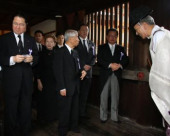 Japan remembers war dead at Yasukuni Shrine August 15 2017 Tokyo Japan  Japanese lawmakers follow a Shinto priest R to honour the war dead at th