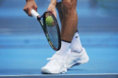 Japanese tennis player on the court