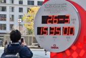 Japan to be affected by coronavirus A man takes photo countdown clock for the Tokyo 2020 Olympics displayed today s date and time at Tokyo Stati