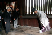 72nd Anniversary of Japan s Surrender in WWII at Yasukuni Shrine A group of lawmakers including Hidehisa Otsuji L  follow a Shinto priest to