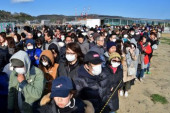 Olympic flame Arrival in Japan People wearing face masks make line during the Tokyo 2020 Olympic Flame of Recovery tour at Ishinomaki Minamihama Tsu