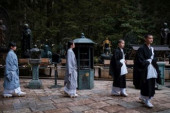 Koyasan morning tribute for Kobo Daishi A group of Buddhism students walks on the path in front of Torodo also knows as Lantern Hall to assist the