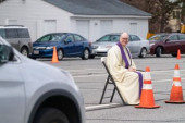 drive up confessions during Covid 19 April 1 2020 Chelmsford Massachusetts USA Father Brian Mahoney at drive up confessions in the parking lot of