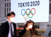 Japan s share prices rebounded over 19 000 yen level March 25 2020 Tokyo Japan  Pedestrians pass before a logo of Tokyo 2020 Olympic Games i